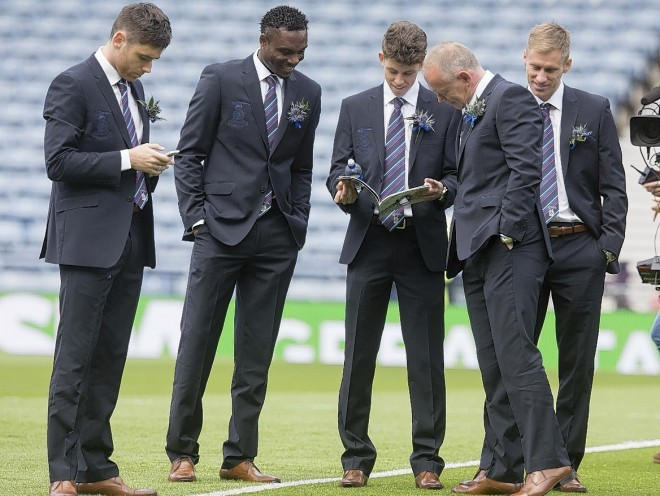 John Hughes and the Caley Thistle squad take to the Hampden pitch to read what the programme has to say about them