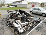 The burnt out remains of the caravan at Caberfeidh Drive, Invergordon