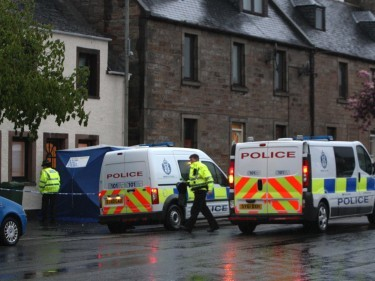 Scene of a stabbing outside number 157 on the high street in Invergorden. Picture: Andrew Smith