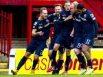 The County players celebrate Liam Boyce's goal
