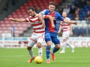 Dougie Imrie (left) battles for the ball with ICT's Iain Vigurs