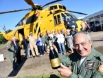 Morayvia director, Bob Pountney, breaks out the champagne to celebrate the Sea King being installed at their headquarters in Kinloss. Picture by Gordon Lennox