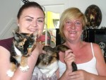 Daisy the cat with owner Mandy Watson, right