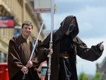 Two Jedi wait for a bus in Scotland