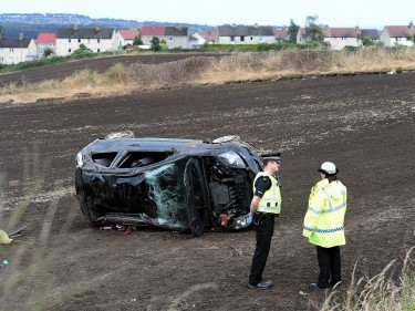 The car landed in a field by the Newhills to Bucksburn Road