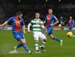Danny Devine, Celtic's Leigh Griffiths and Gary Warren battle for the ball