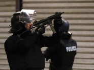 Police forces prepare in St. Denis, a northern suburb of Paris