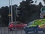 Car reversing on roundabout