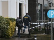 Gardai outside the Regency Hotel in Dublin after one man died and two others were injured following a shooting at the hotel.