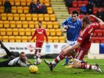 Adam Rooney (right) opens the scoring for the Dons on Saturday