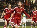 Simon Church celebrates his goal against Celtic