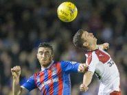 Inverness' Ross Draper and Rangers' Jason Holt  battle for the ball