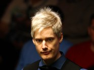 Neil Robertson suffered a first-round defeat at the hands of Ryan Day at the Shanghai Masters