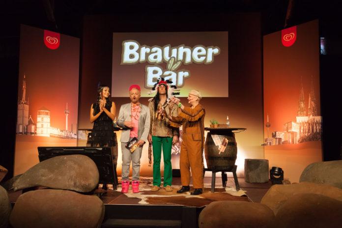 Komikerin Hella von Sinnen und Moderatorin Verona Pooth haben sich gestern Abend beim ersten deutschen Comedy Roast einen verbalen Schlagabtausch geliefert. Anlass für das Wortgefecht war die Rückkehr des Langnese Kult-Eises Brauner Bär. Der Häuptling, der dem Eis seinen Namen gibt, hat kurz vor der heißen Karnevalszeit Deutschlands wohl meist verfeindete Städte zusammengebracht