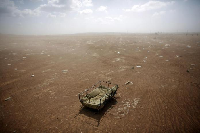 A cradle left behind by Syrian Kurdish refugees lies at the Turkish-Syrian border near Suruc in Sanliurfa province