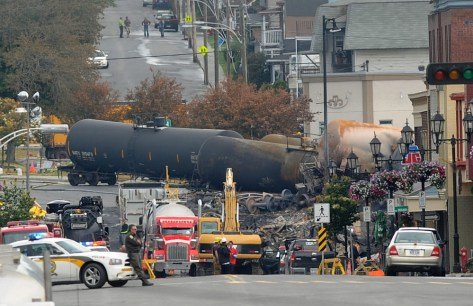Crude oil tankers from the Montreal, Maine & Atlantic railways are seen in the heart of downtown Lac-Megantic, Quebec, on July 9, 2013, two days after a train derailed then ignited, burning much of the town.