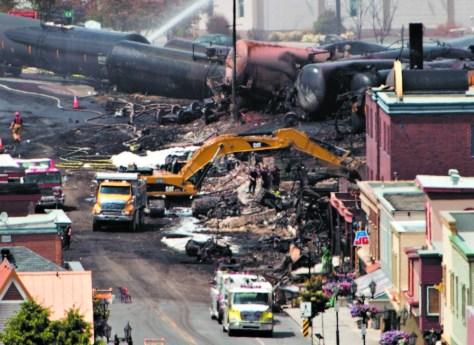Searchers dig on July 8, 2013, through rubble on a search for victims of the inferno in Lac-Megantic, Quebec, a day after a runaway train derailed, igniting tanker cars and burning much of the town, killing 47 people.