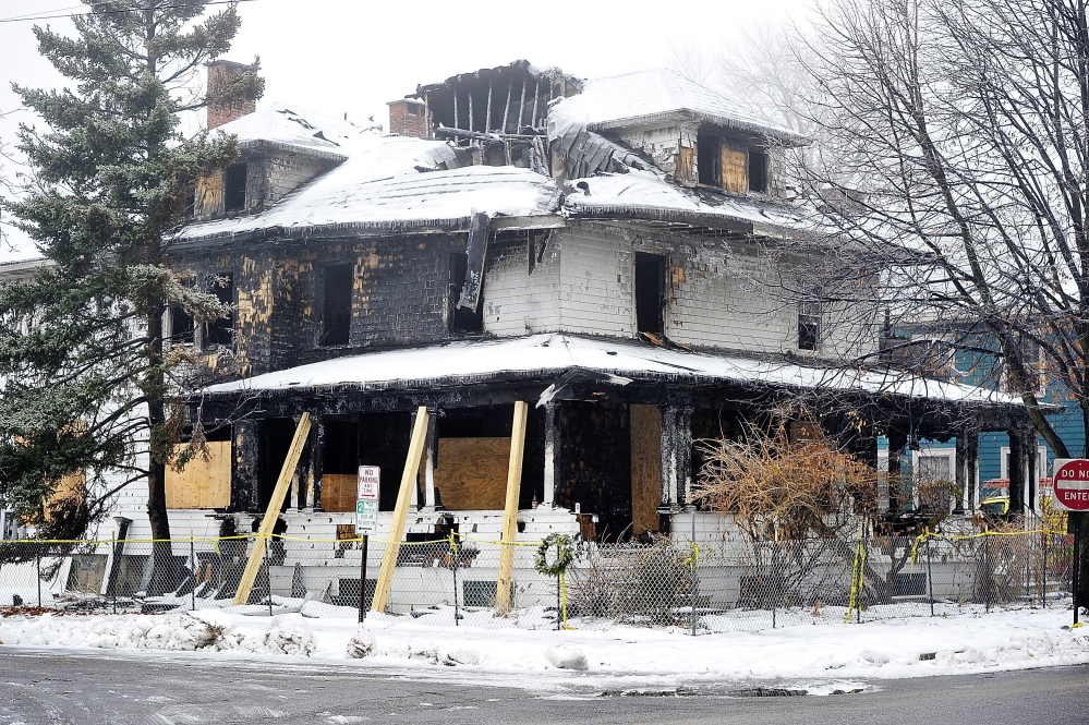 The heavily damaged building remains at 20 Noyes St. in Portland. Sworn statements from a former tenant and two fire survivors indicate there were no smoke detectors in one side of the duplex and a bookcase blocked a back stairway, forcing tenants to jump from a second-story window.