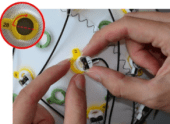 Figure 7: Removing actiCAP slim electrodes from their snap holders.
