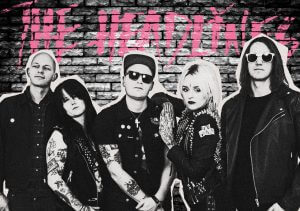 THE HEADLINES Punkrock Band brick wall black and white graffiti beadboard Garage