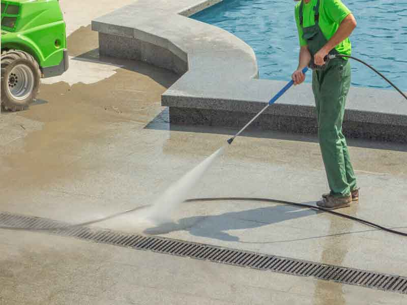 clean pool tile with pressure washer