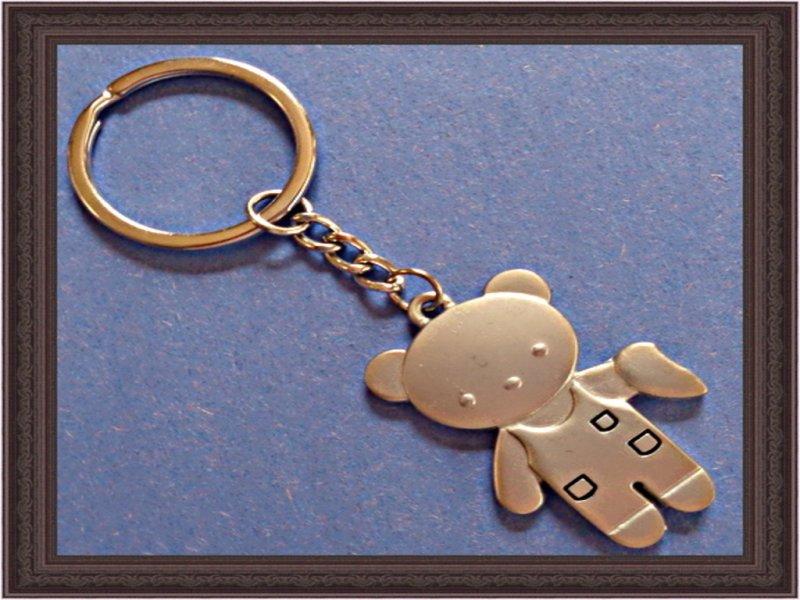 silver tone teddy bear
