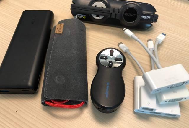 Picture of USB Adaptors, Ethernet dongles, VGA, Kensington Remote, Anker USB-C battery, power strip.
