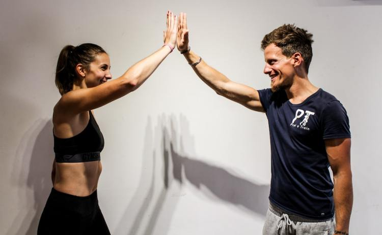 Personal trainers in Perth with client happy
