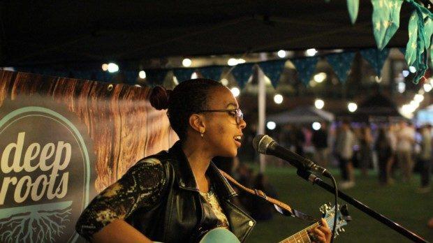 girl with guitar singing Deep Roots Market Pretoria