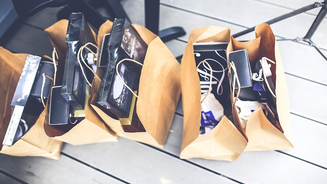 brown paper shopping bags on a white panel wooden floor
