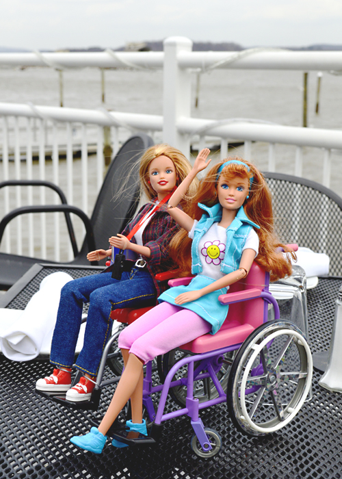 Wheelchair Barbies waving by the Hudson River
