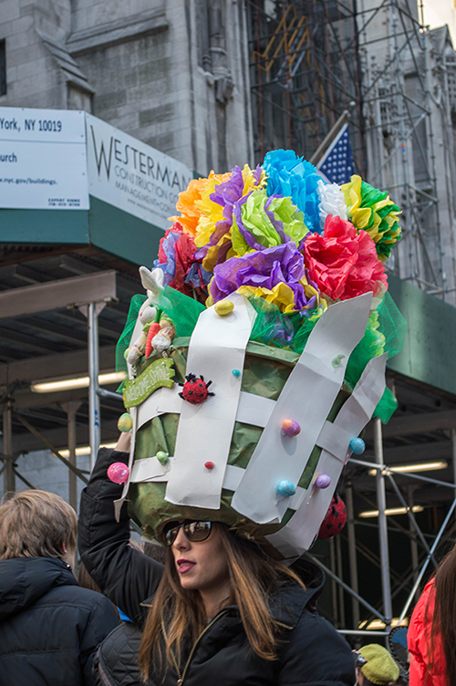 woman with potted plant on her head easter nyc hat parade