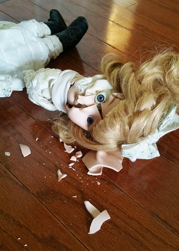 Cracked broken porcelain baby doll