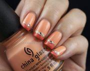 pretty orange nail design