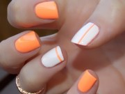 pretty orange nail design