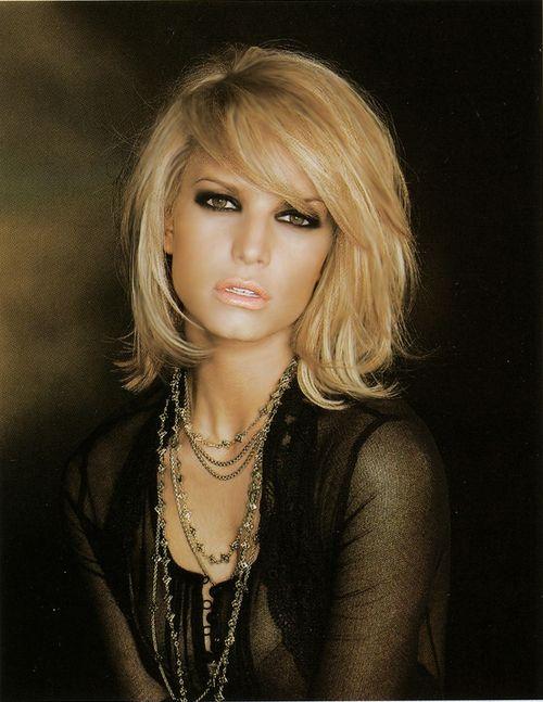Charming Medium Blond Wavy Haircut