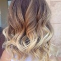 Shoulder length curly hairstyle for ombre hair via