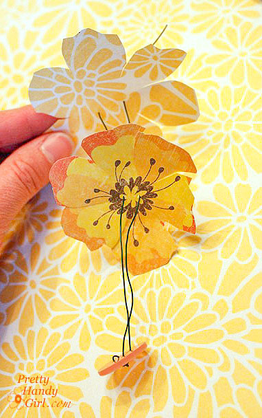 thread paper flowers and button onto wire