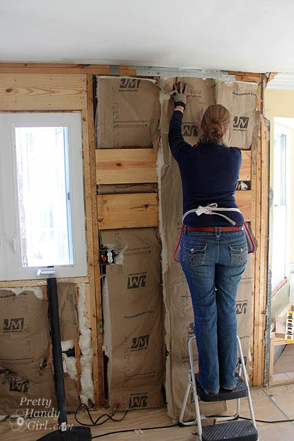 handy_girl_hanging_insulation