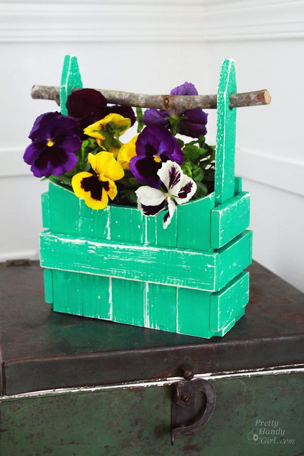 pansies_planter_on_rustic_trunk
