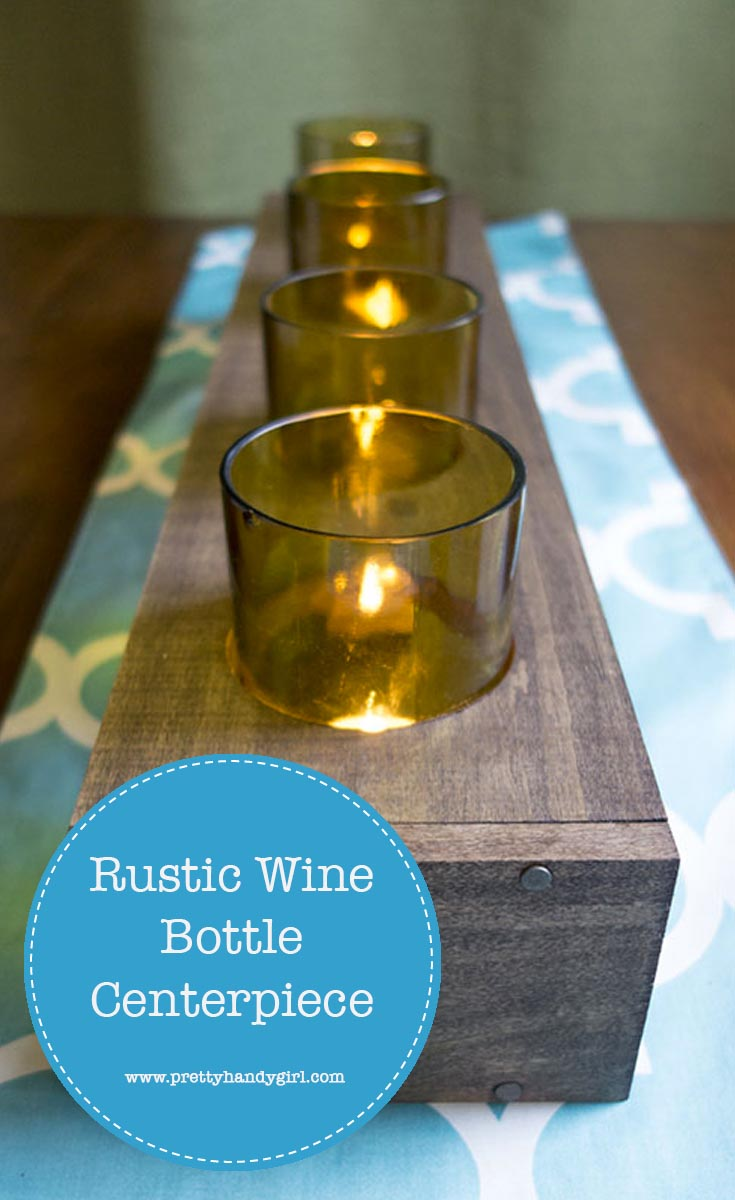 Easily upcycle old glasses with this DIY rustic wine bottle centerpiece from Pretty Handy Girl! | Upcycle project | rustic table centerpiece #prettyhandygirl #DIY #tabledecor