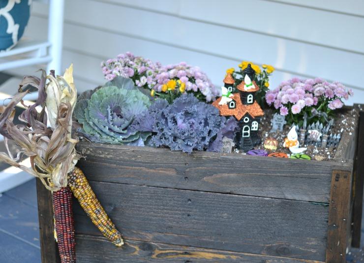 Add a fun Halloween Ghostly Garden to your fall planter. | PrettyHandyGirl.com