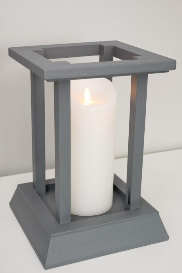 This candle lantern is easy to make using leftover trim from my fireplace makeover!