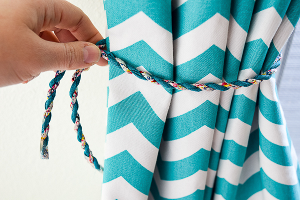 Measure the curtain tie back cord to make sure it is tight enough to hold the curtains in place.