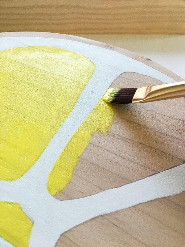 Paint the inside segments and outside edge of the lemon bright yellow.