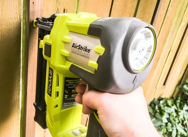 Use a nail gun to attach the vertical pieces directly to the fence.