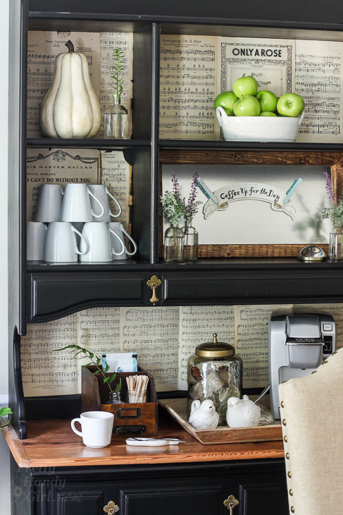 Coffee bar set up in dining room hutch