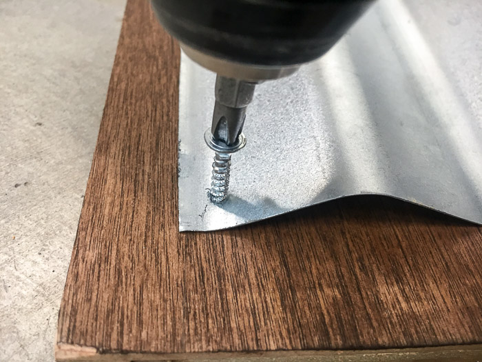 How to attach metal to wood