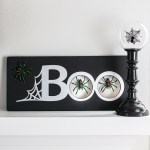 This black and silver Halloween sign is a spooky way to decorate for the holiday.