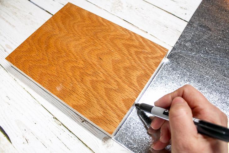 1. Cut base and mark sheet metal size.